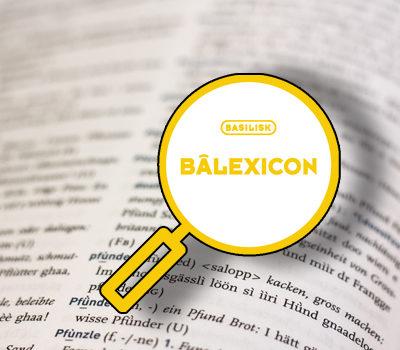 Logo Balexikon, Lupe zeigt auf Baseldeutsches Wörterbuch